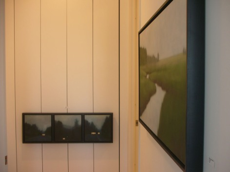 The triptych is hanging on closet door pulls, here, as well.
