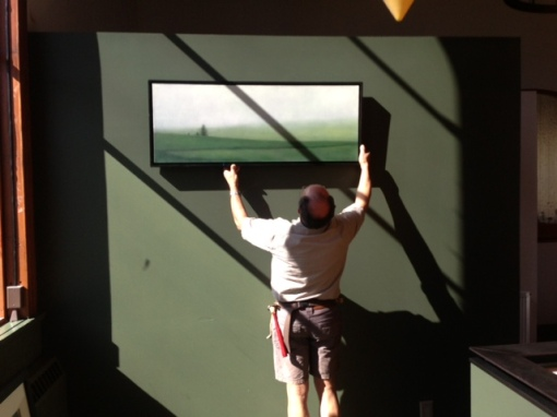 Albert, genius curator and installer, hanging the third to go up.