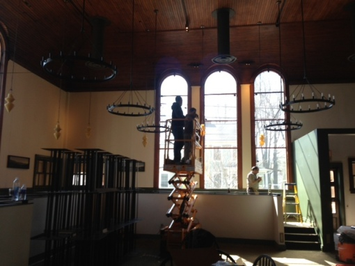 The fellows with the lift installing new lighting.